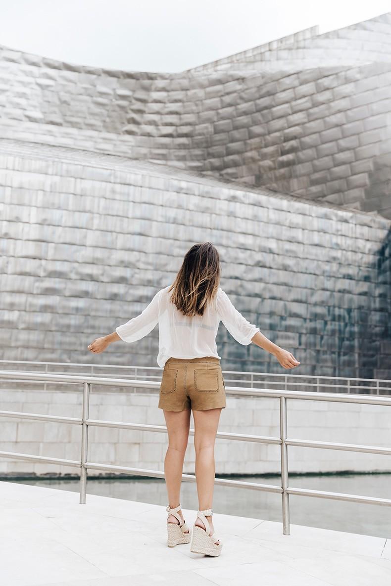 Polo_Ralph_Lauren-Bilbao-Collage_Vintage-Ruffled_Lace_Up_Blouse-Deerskin_Fringe_Short-Cardigan-Raffia_Wedges-Guggenheim-45