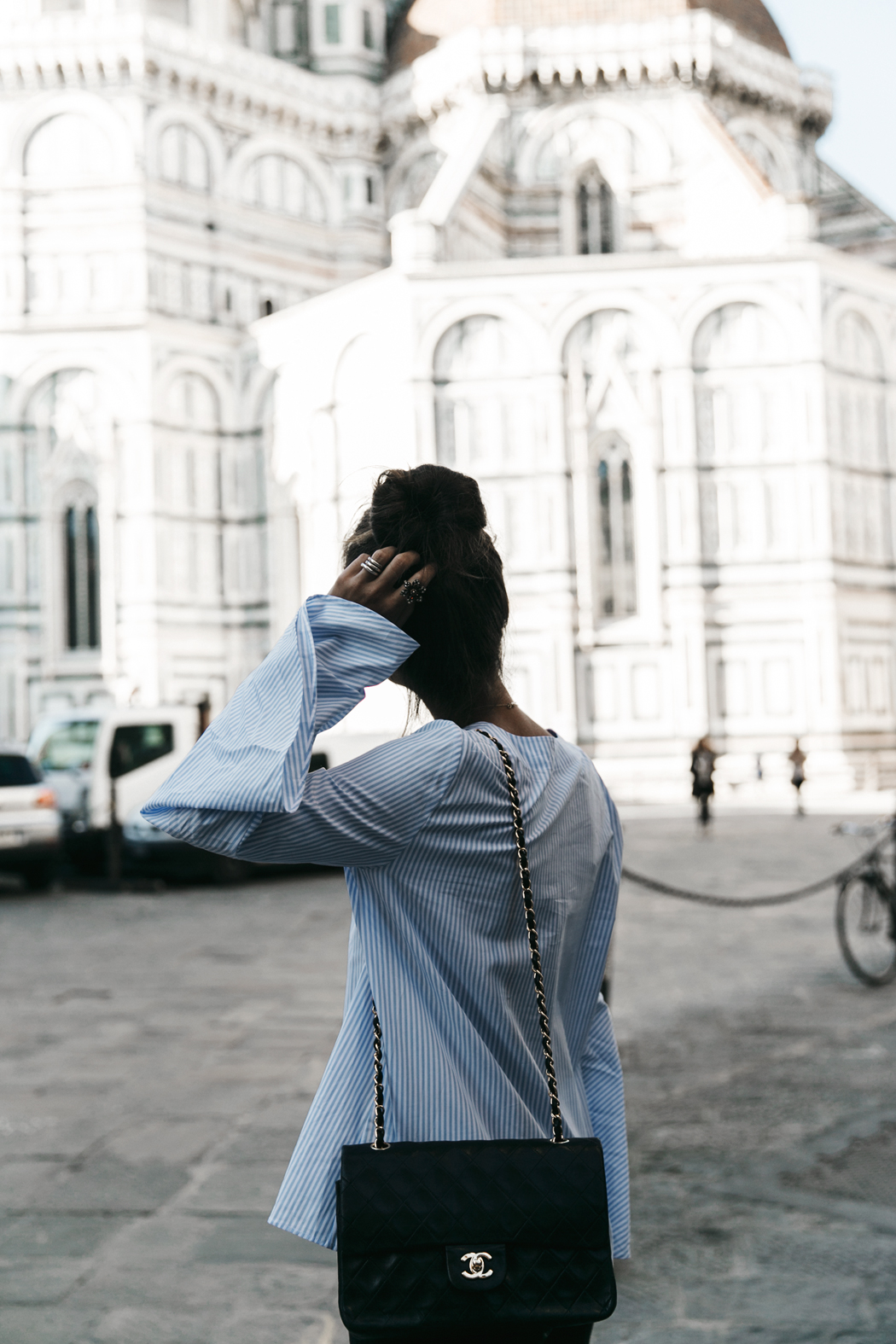 Florence-Collage_On_The_Road-Black_Jeans-Chanel_Slingback_Shoes-Blue_Shirt-Uterque-Topknot-Outfit-63