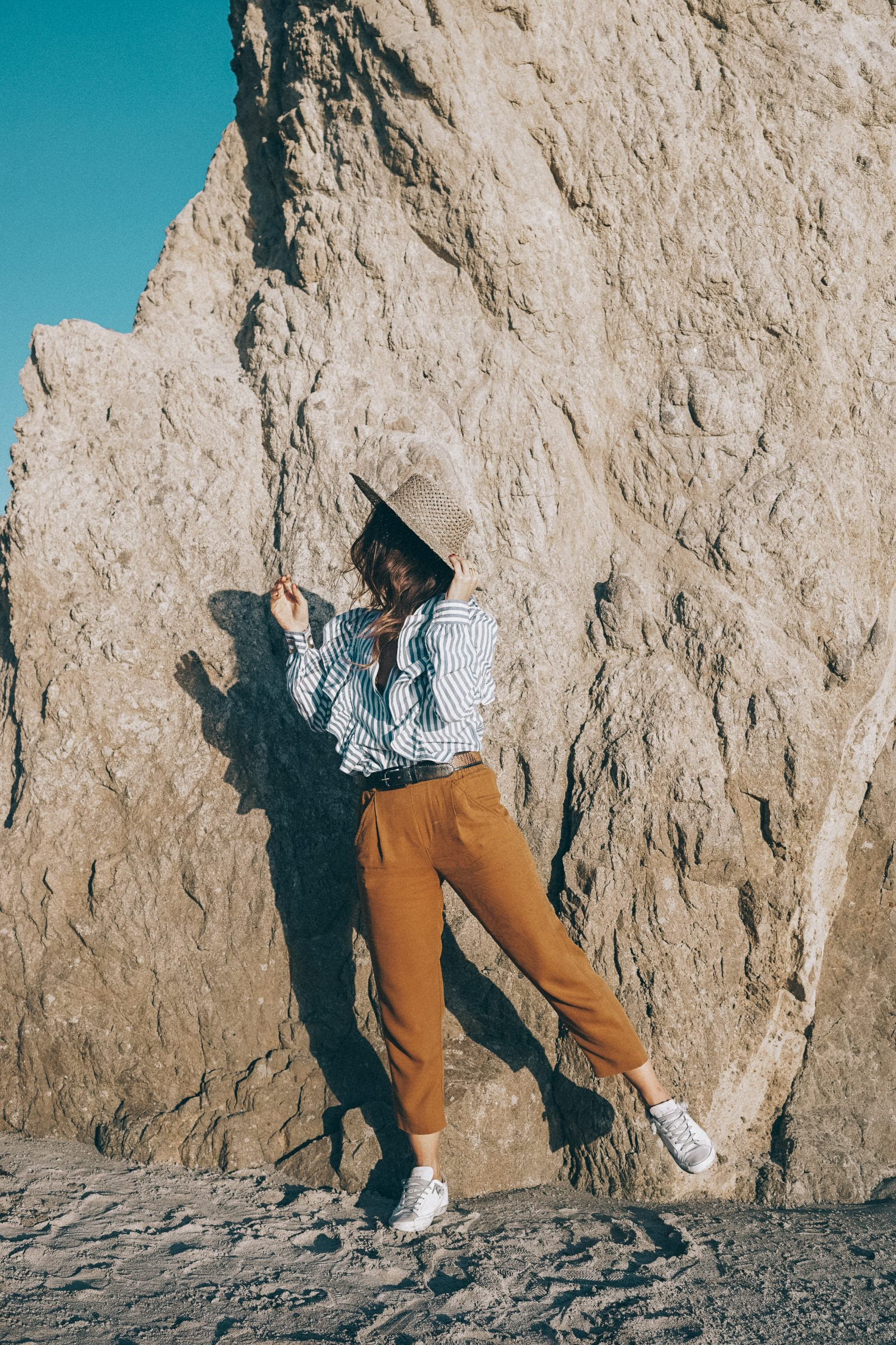 stripped_blouse-camel_trousers-lack_of_color_hat-wanderlust_jewels-matador_beach-malibu-golden_goose_sneakers-street_style-collage_vintage-111