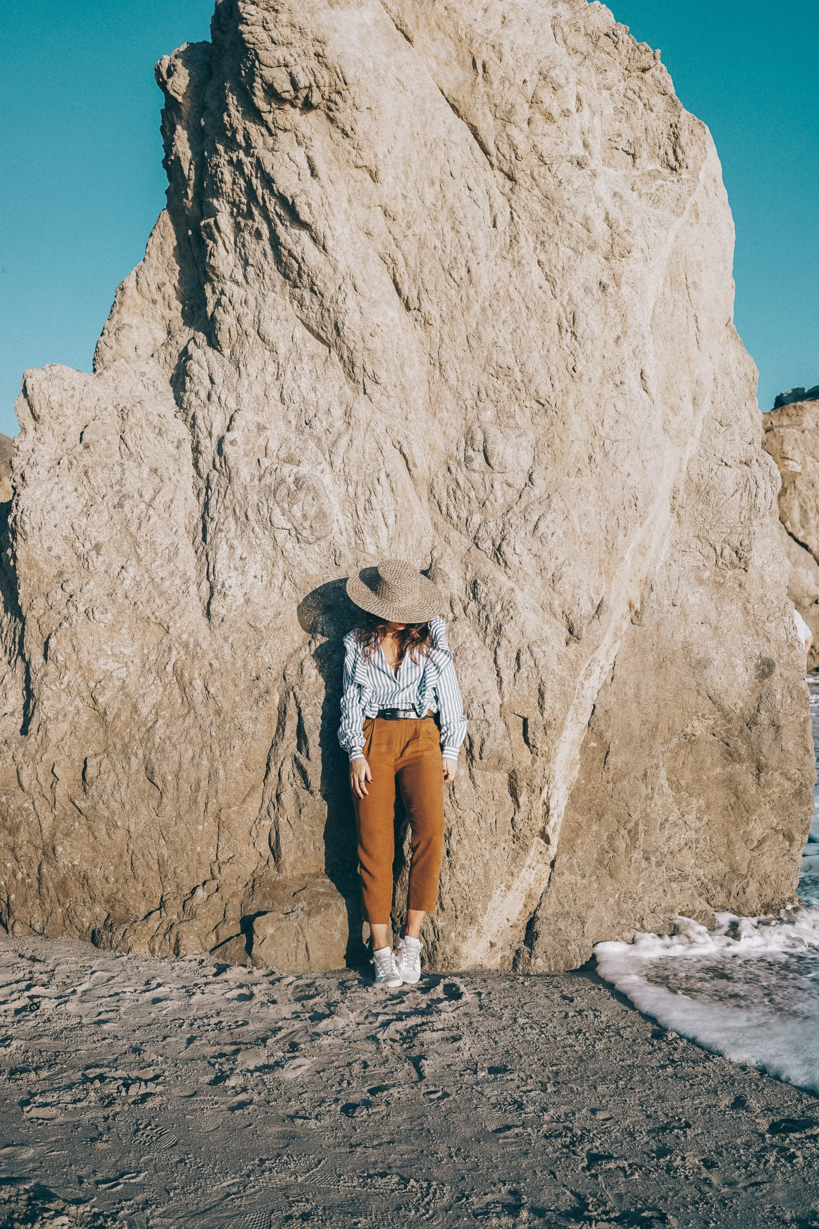 stripped_blouse-camel_trousers-lack_of_color_hat-wanderlust_jewels-matador_beach-malibu-golden_goose_sneakers-street_style-collage_vintage-117