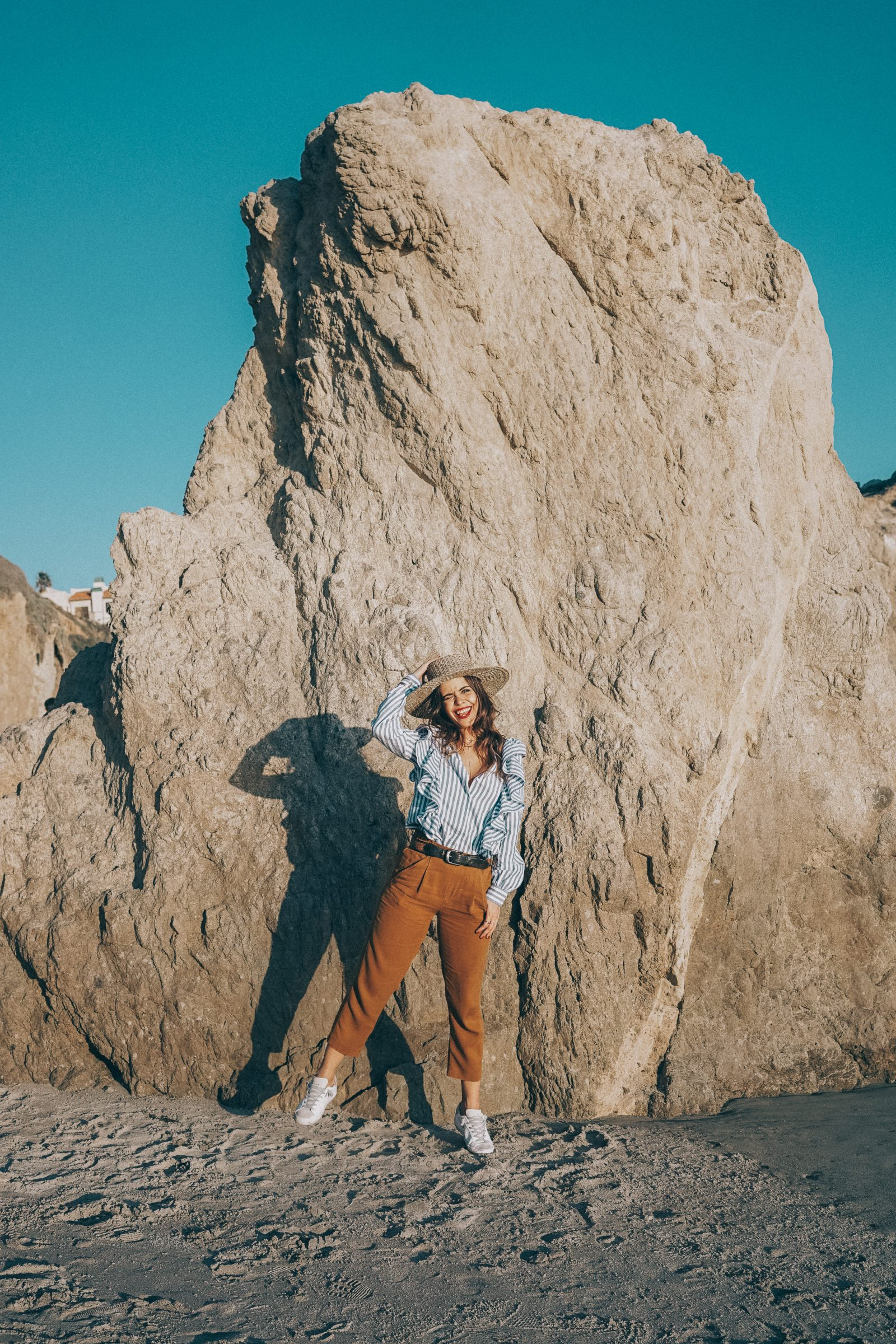 stripped_blouse-camel_trousers-lack_of_color_hat-wanderlust_jewels-matador_beach-malibu-golden_goose_sneakers-street_style-collage_vintage-129