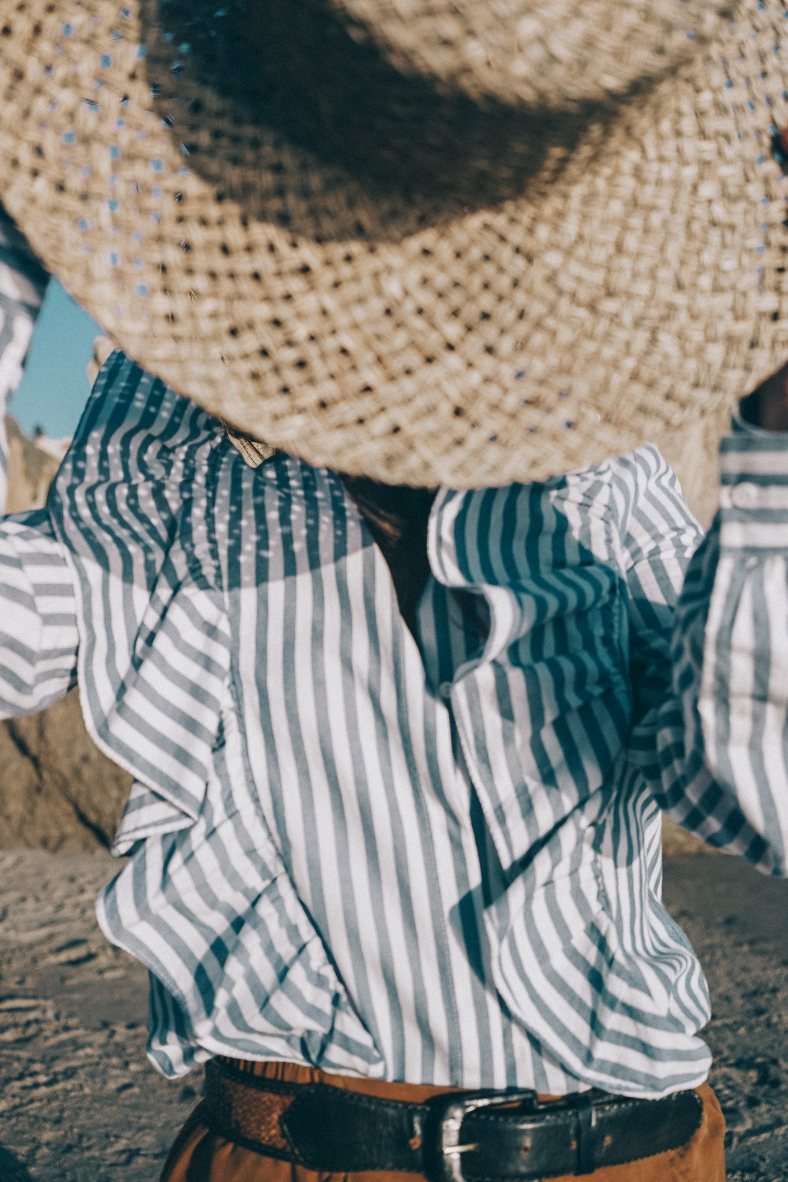 stripped_blouse-camel_trousers-lack_of_color_hat-wanderlust_jewels-matador_beach-malibu-golden_goose_sneakers-street_style-collage_vintage-138