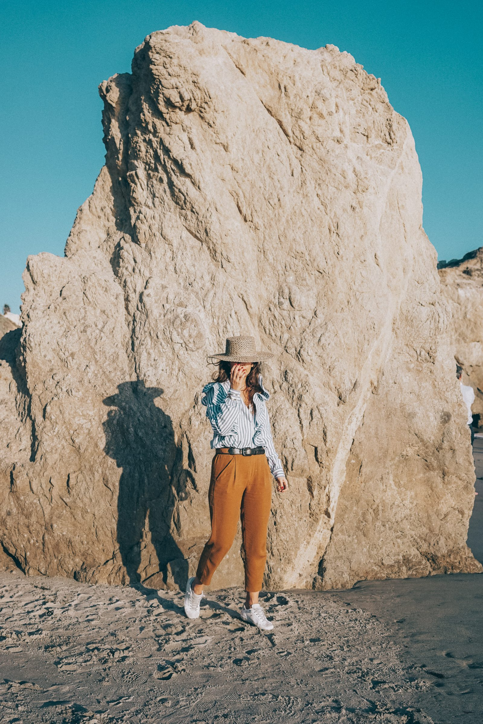 stripped_blouse-camel_trousers-lack_of_color_hat-wanderlust_jewels-matador_beach-malibu-golden_goose_sneakers-street_style-collage_vintage-159