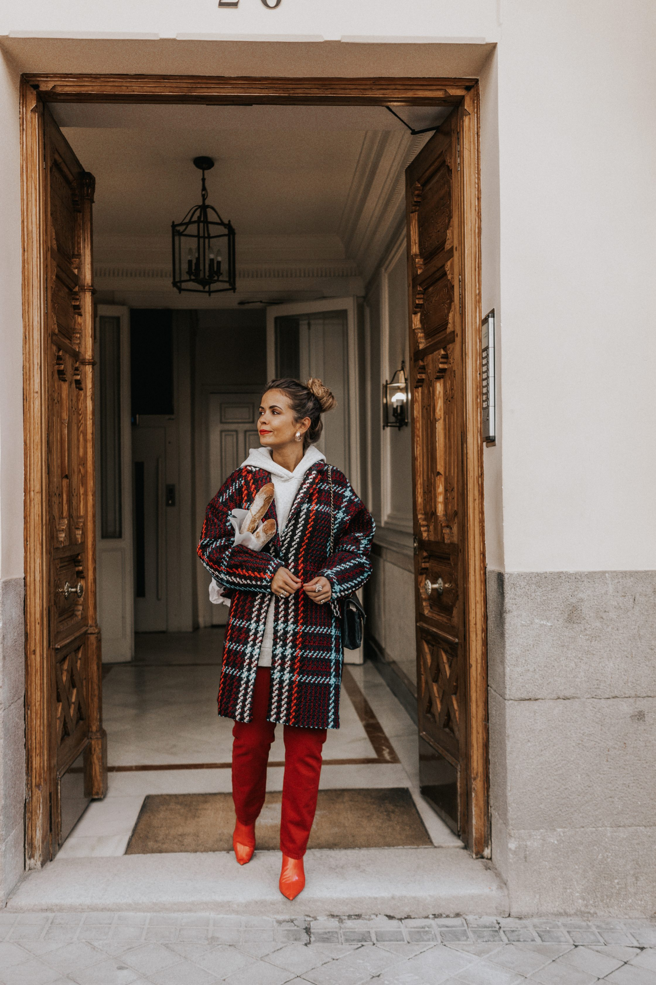 Sara of Collage Vintage wearing plaid coat and red trousers