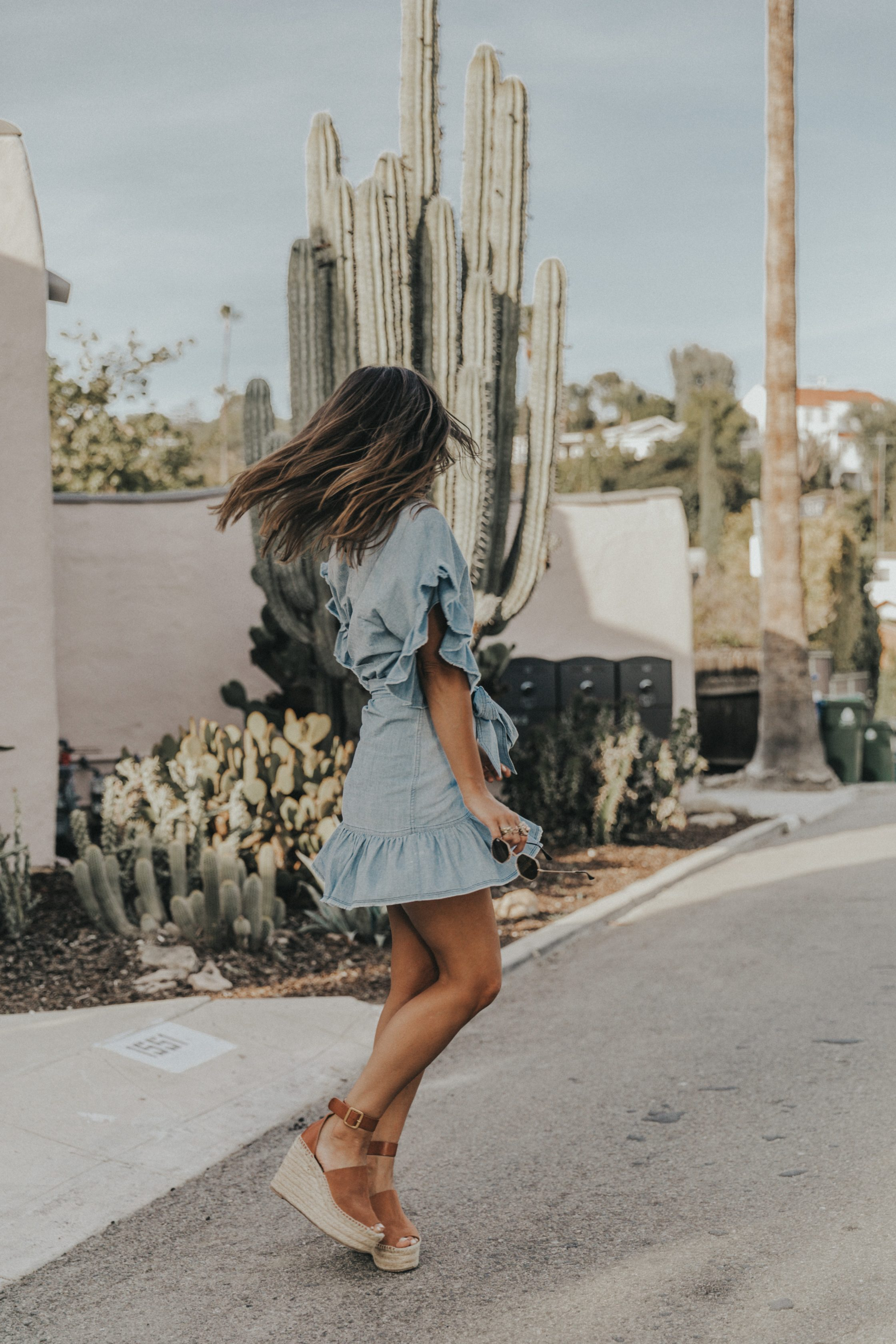 Sara of Collage Vintage wearing a Isabel Marant ruffled denim dress
