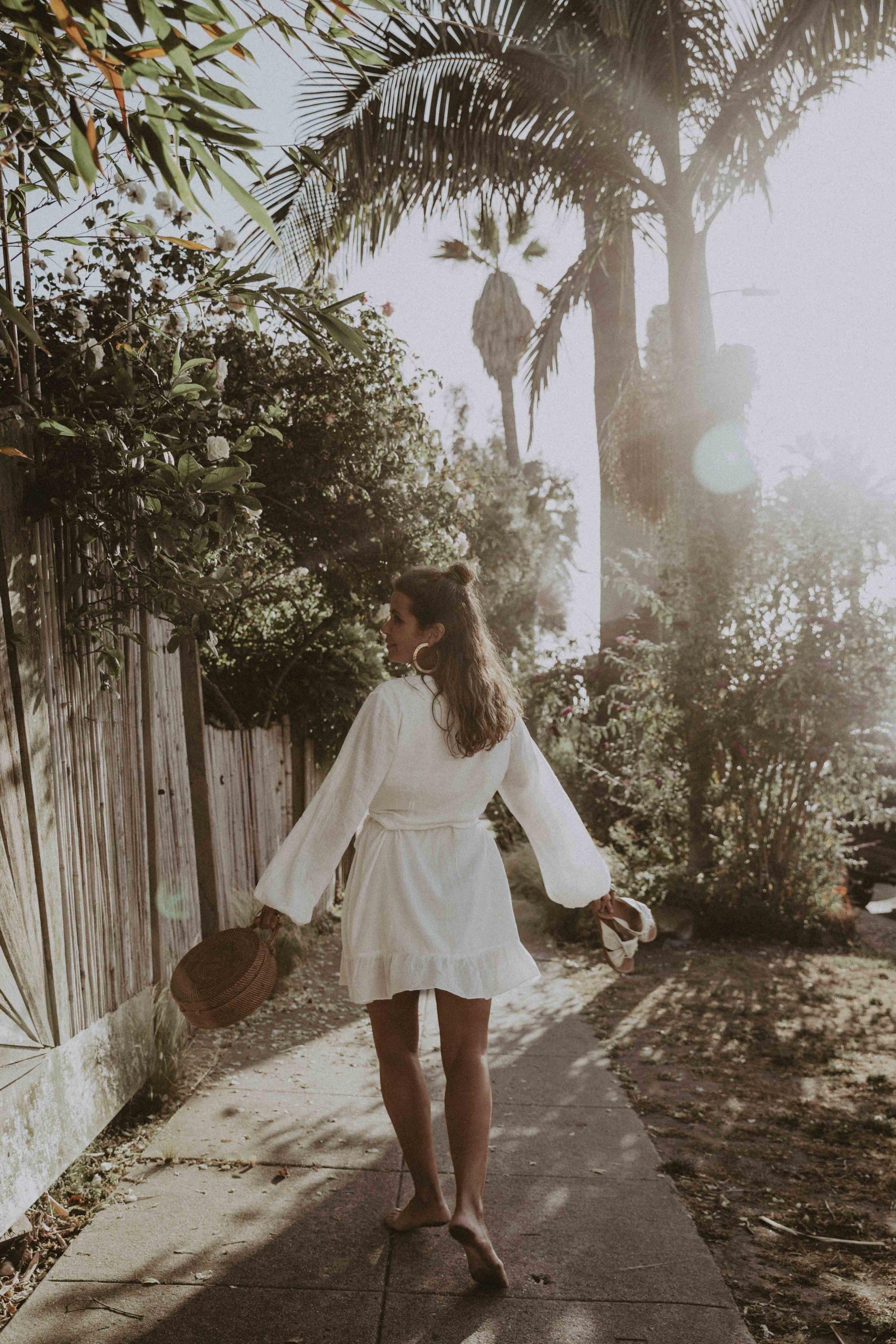 Summer dress and flat sandals around Venice Beach, California