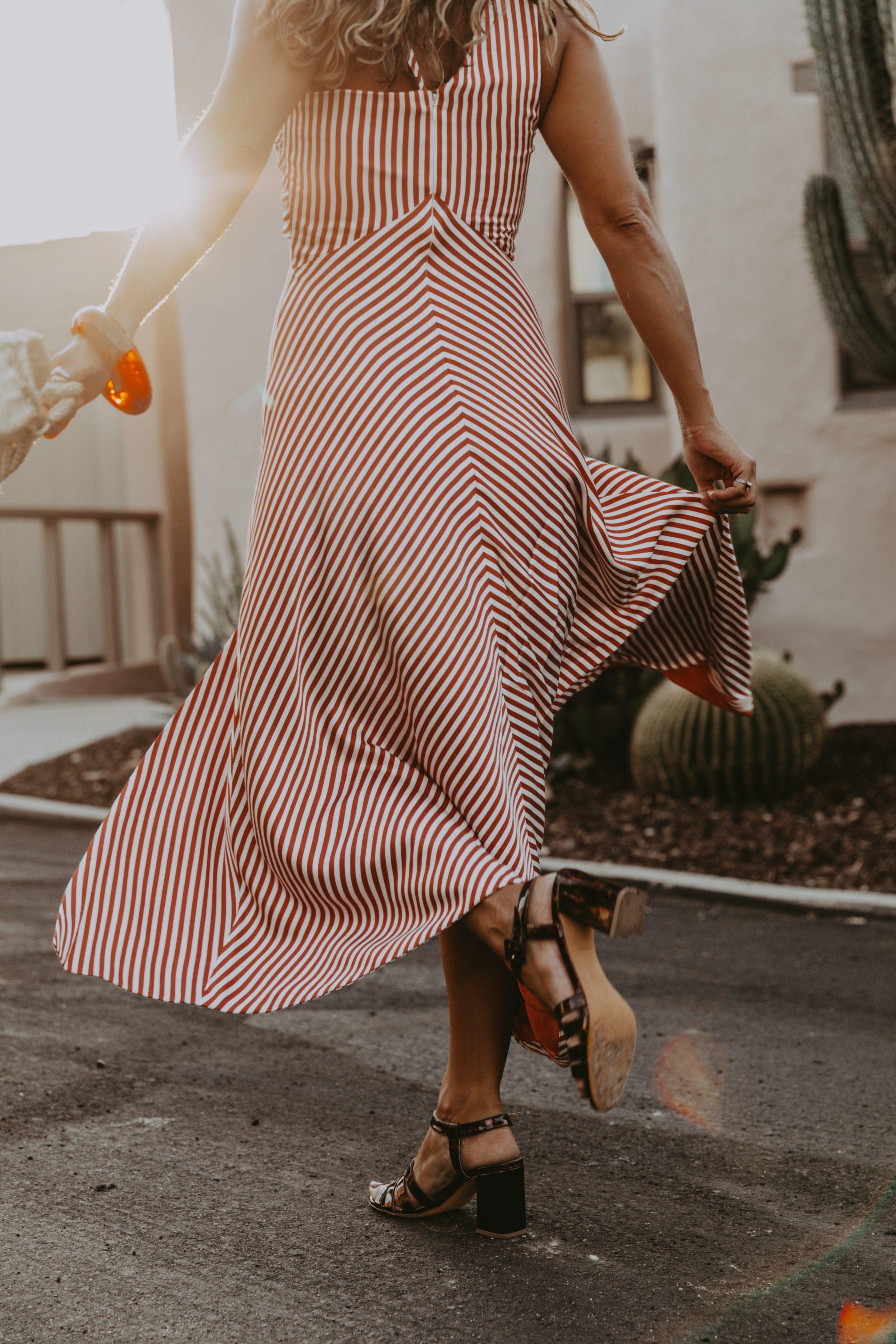 Sara Escudero for Collage Vintage is wearing a Jonathan Simkhai striped dress