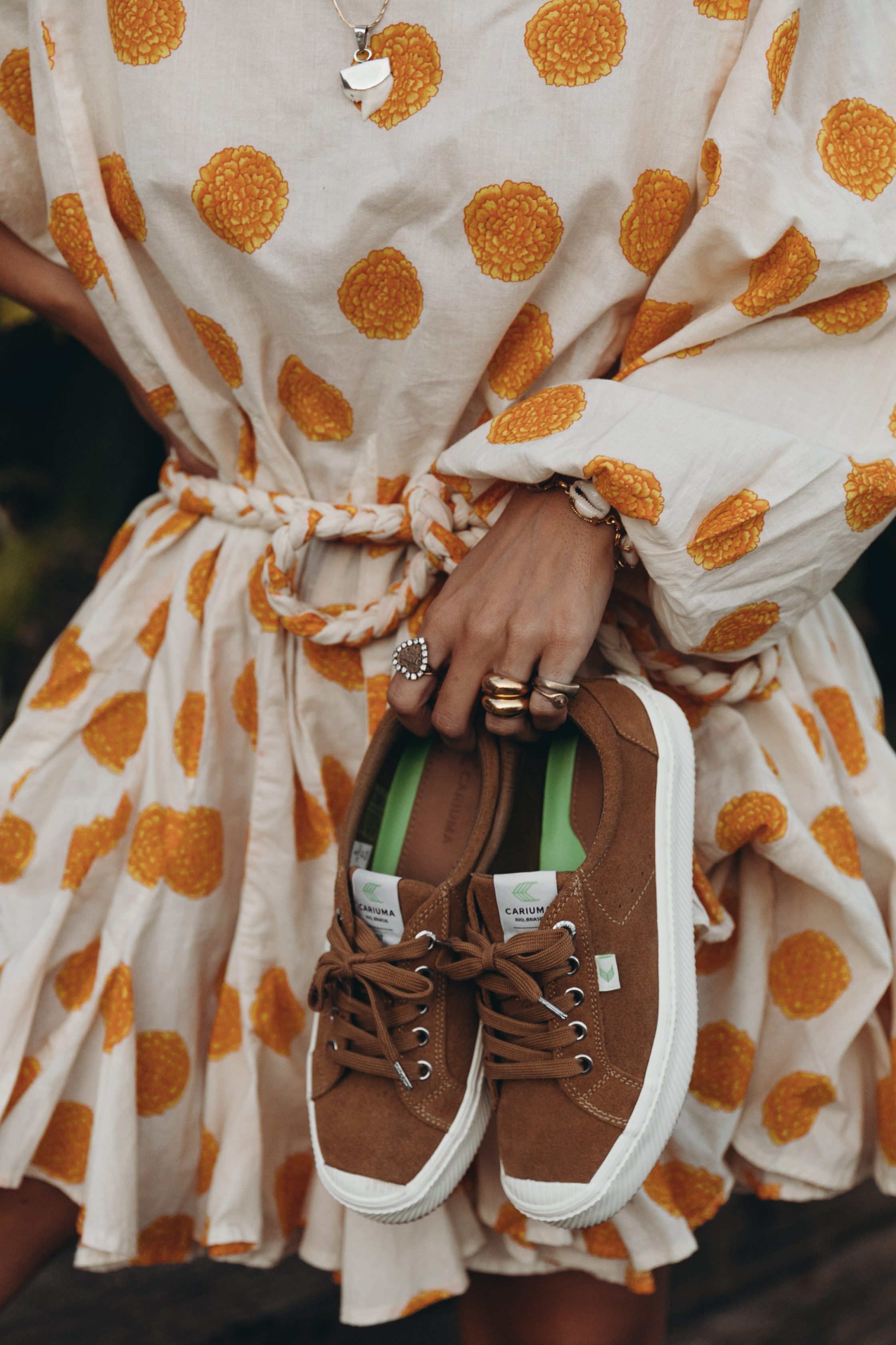 Sara Escudero of Collage Vintage wearing a Rhode dress and Cariuma suede sneakers