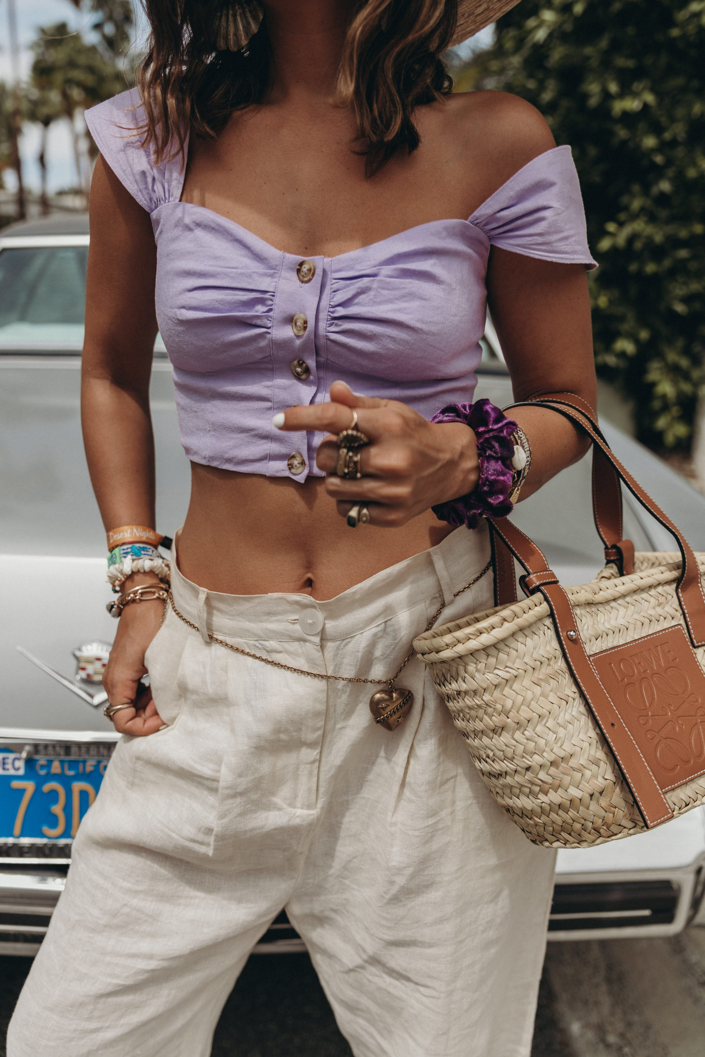 Sara of Collage Vintage wearing a LPA lilac top and baggy pants for attending Coachella 2019