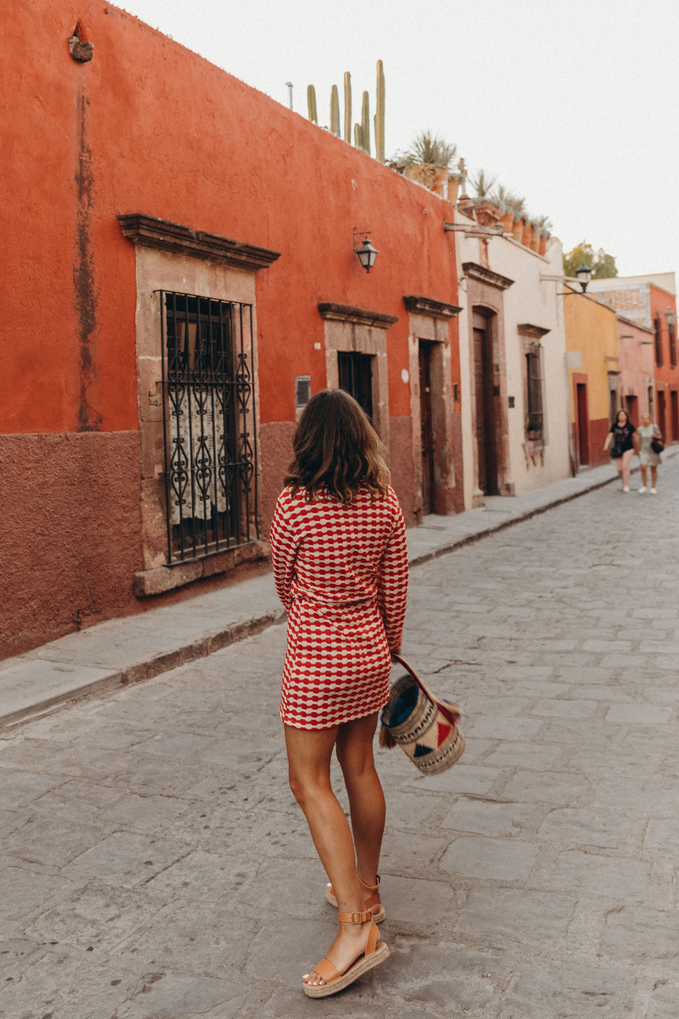 Sara of Collage Vintage wearing a red dress from Zara and leather espadrilles at San Miguel de Allende