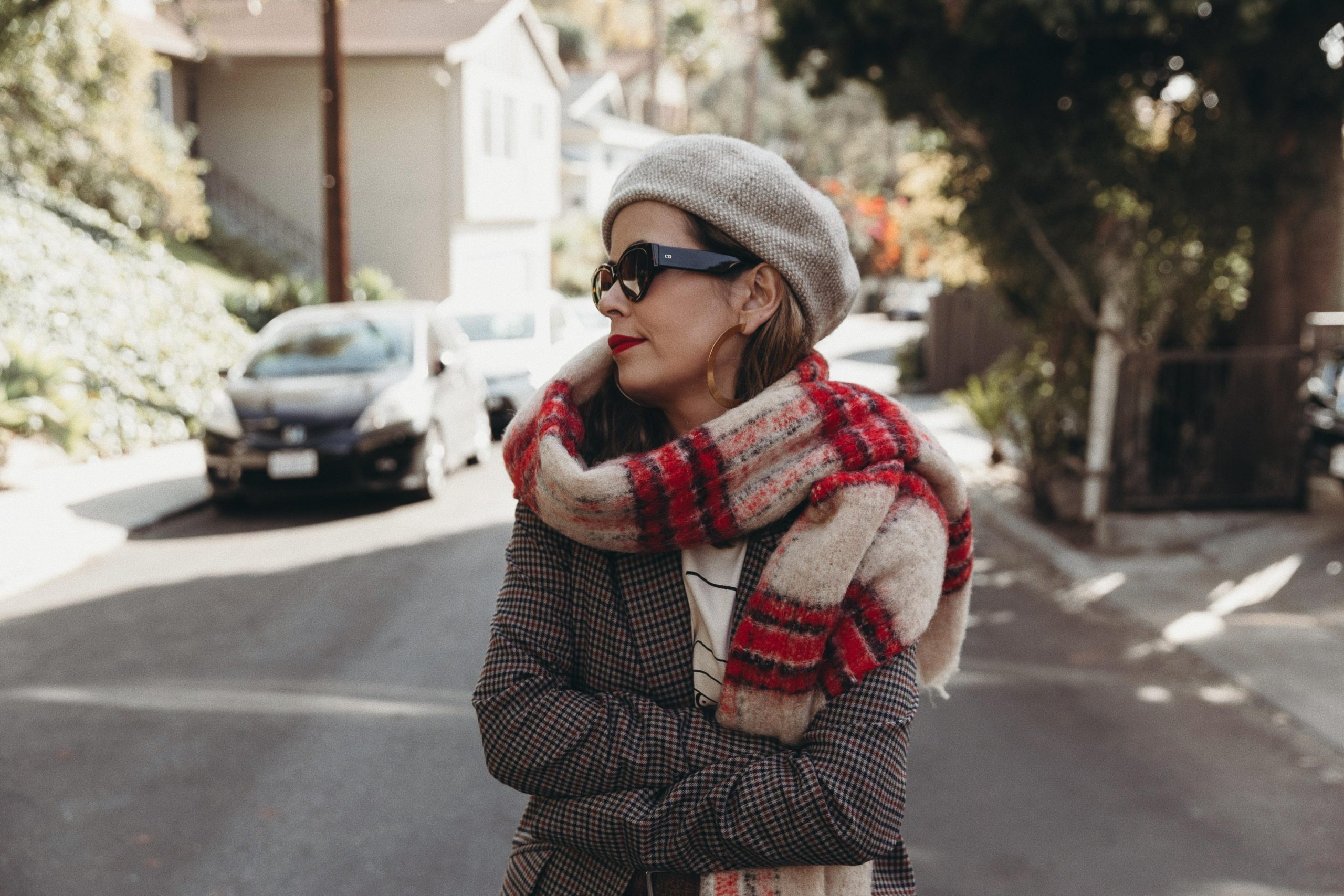 Sara from Collage Vintage wearing a checked suit and wool beret for Black Friday