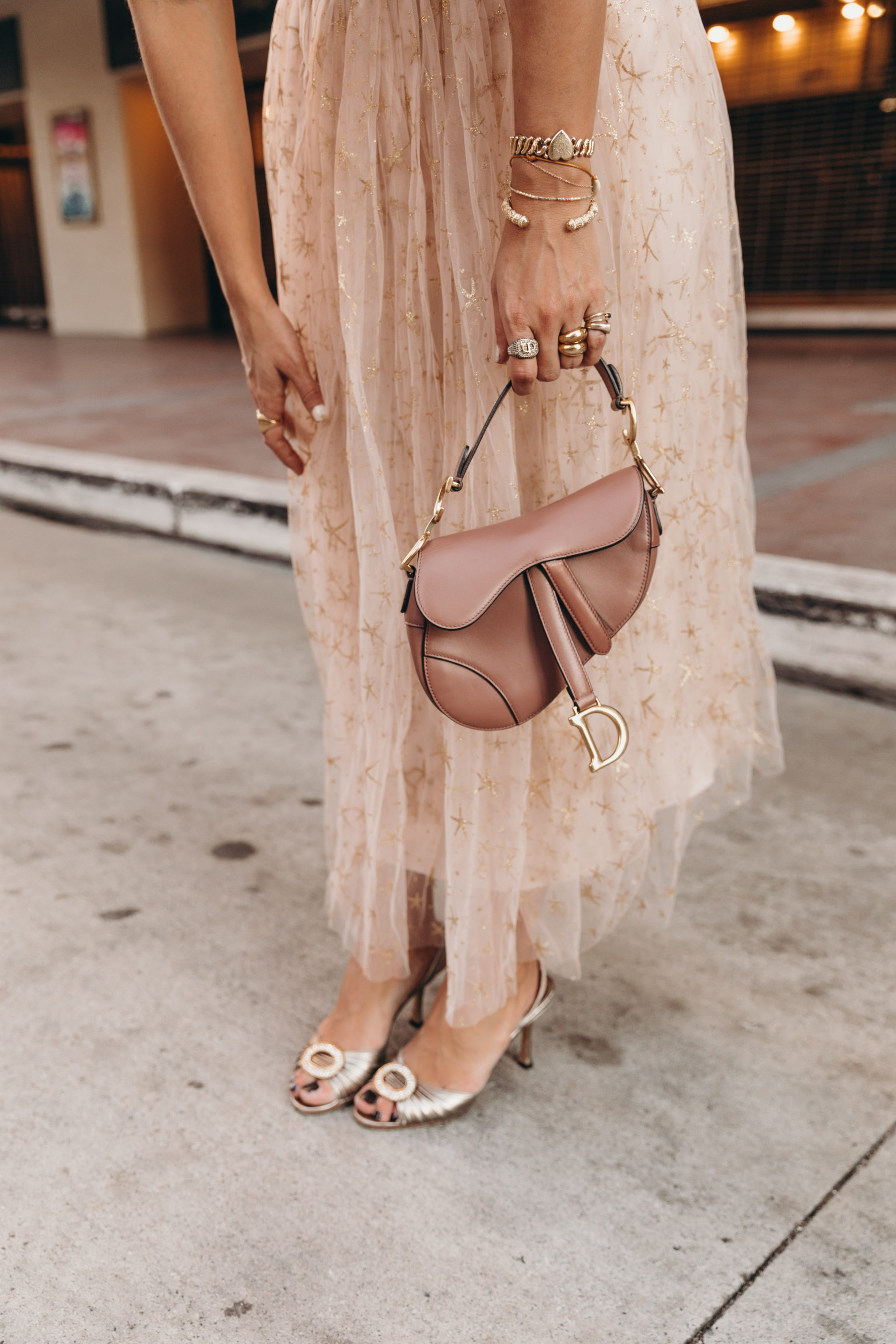 Party outfit wearing a Champagne tulle dress and Manolo Blahnik sandals